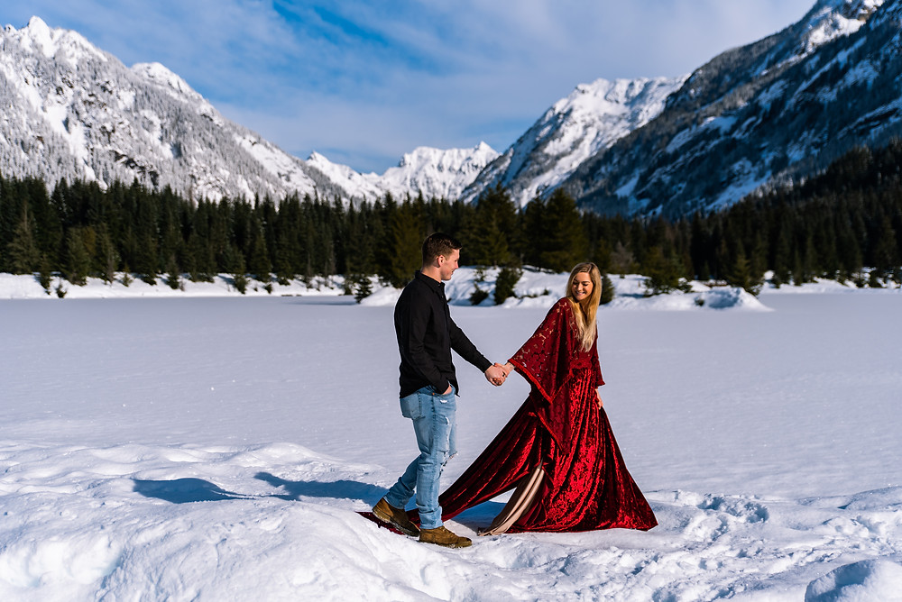 A girl leads her husband in front of Gold Creek Pond in Washington on their adventurous wedding day