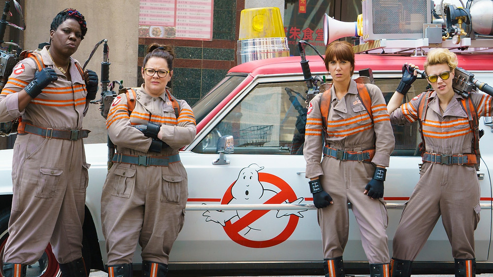Four female ghostbusters posing