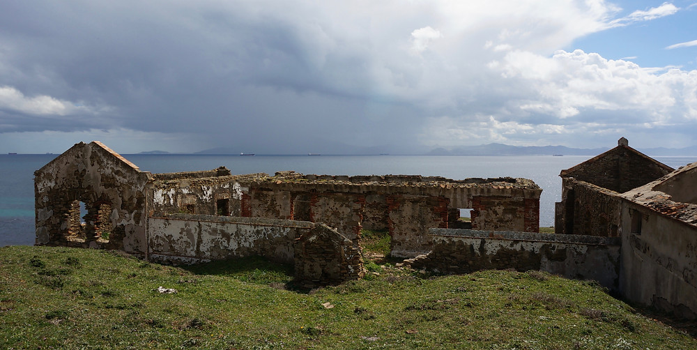 Ruins and view across the Straits to Morocco, stormy weather.