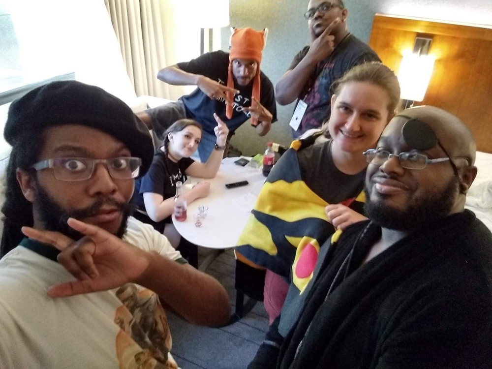 A group of friends playing the popular game Black Card Revoked at Blerdcon