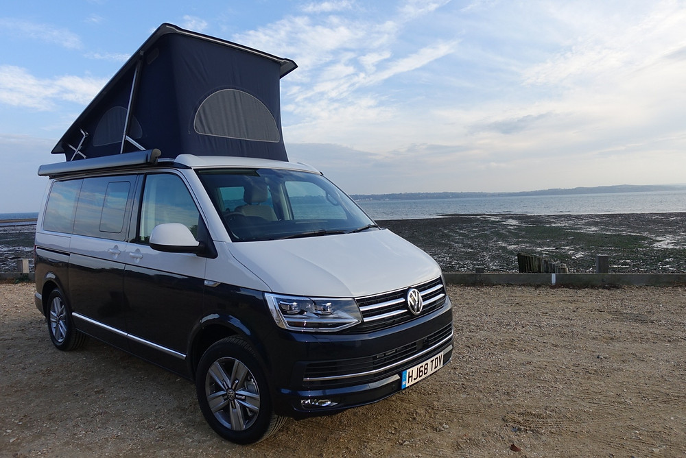 VW California Ocean on the beach with the roof up