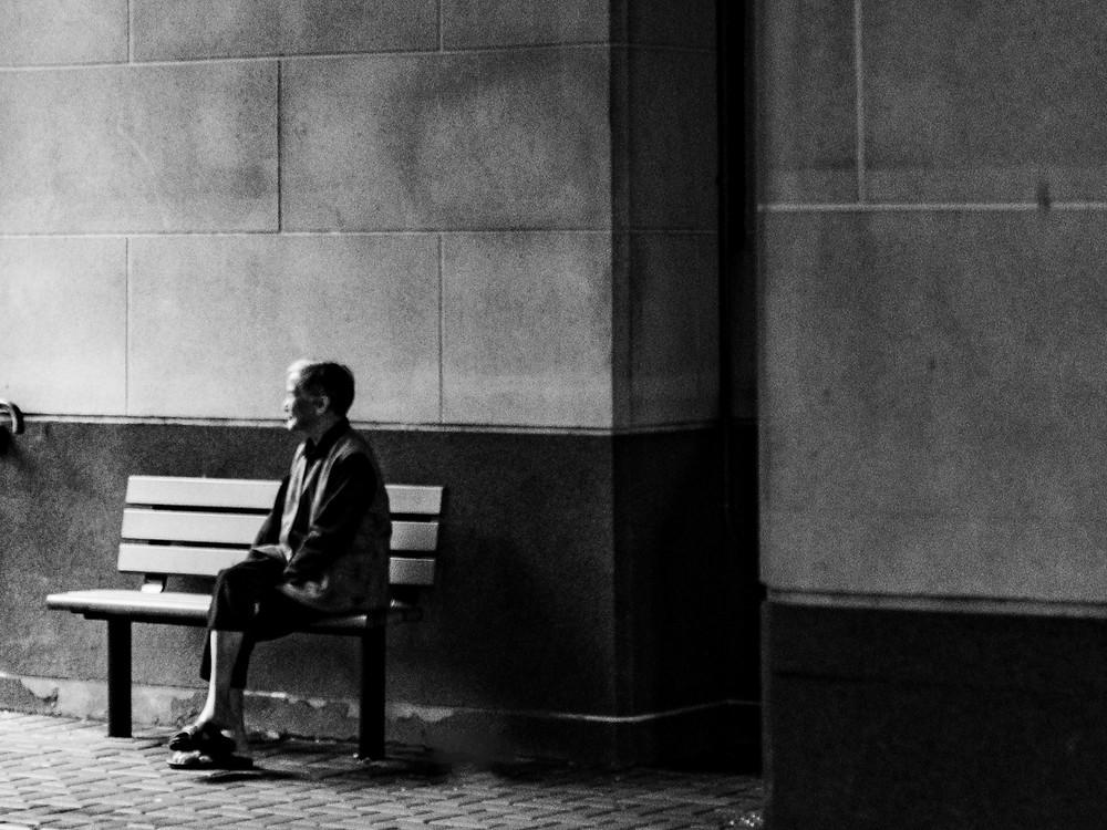 Elderly lady sitting by herself