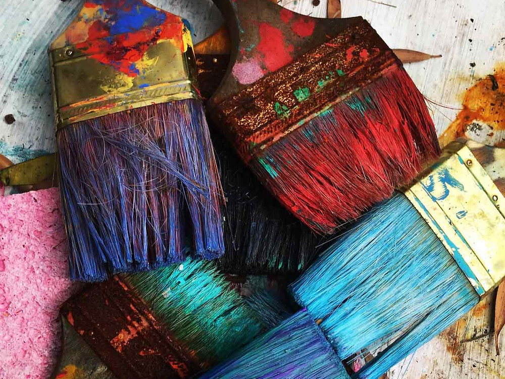 paint brushes covered in paint