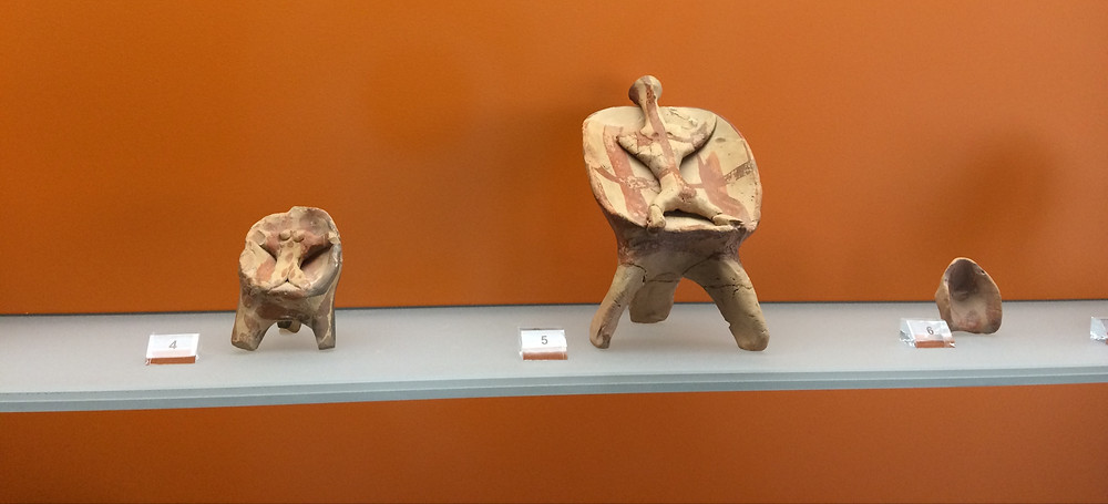 clay figurines in a chair from delphi Greece