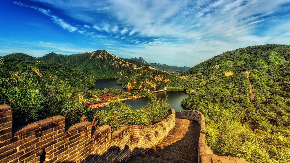 Great Wall of China extending into the distance over hilltops and through valleys, China