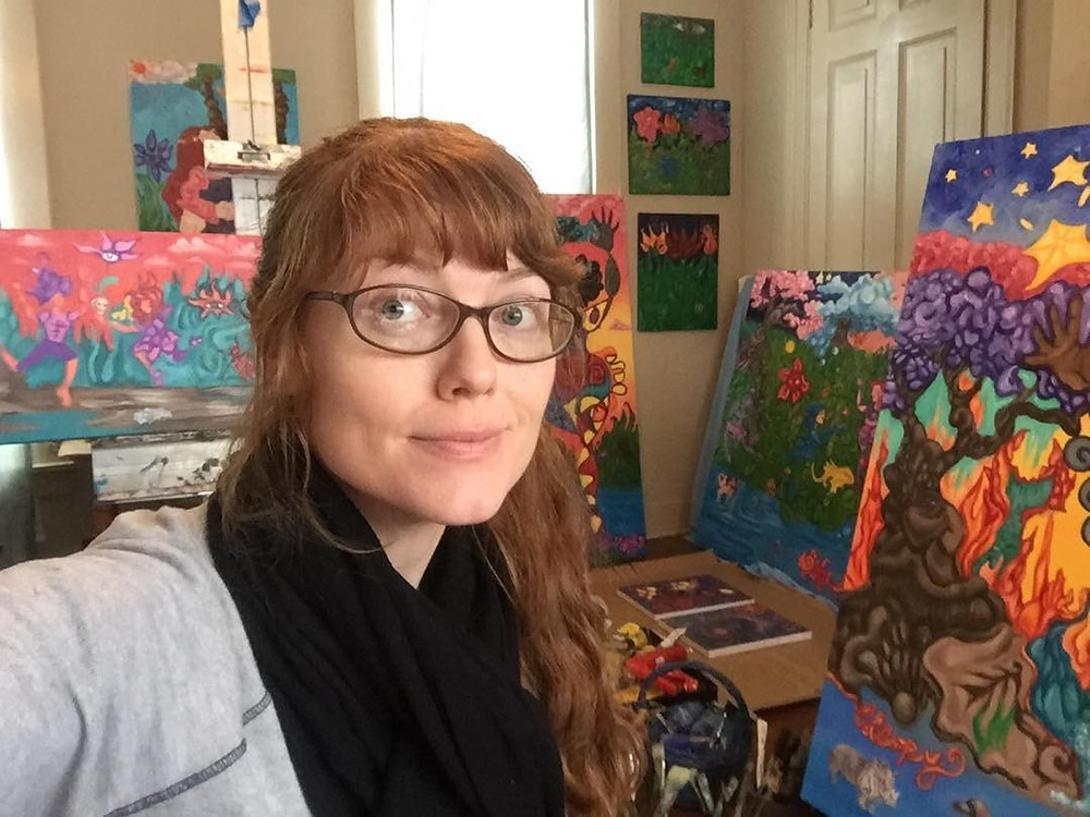 Chrissy poses with her art for a selfie! Follow her instagram @sapphiresunfish to keep up with her latest works!