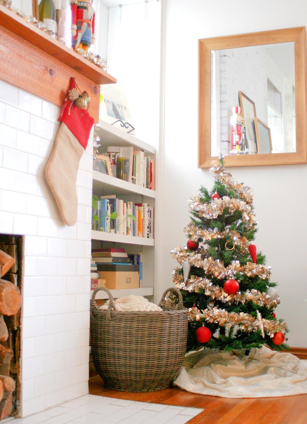 A tiny Christmas tree warming up the living room.