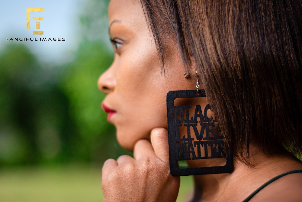 Kemone Hendricks wearing the Black Lives Matter earrings she's selling to help ensure that Juneteenth can be celebrated in Evanston in the future.