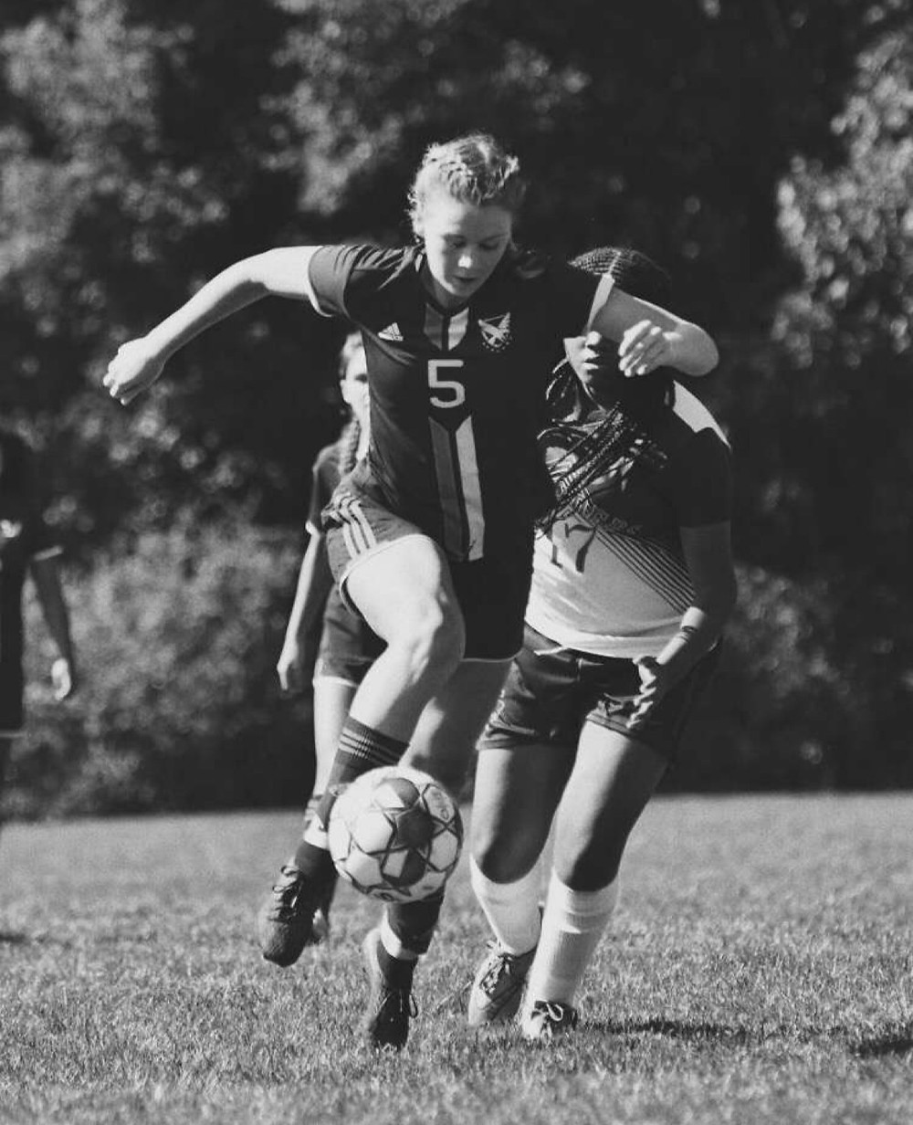 Captain Nicole Foster pushing the ball up the field.