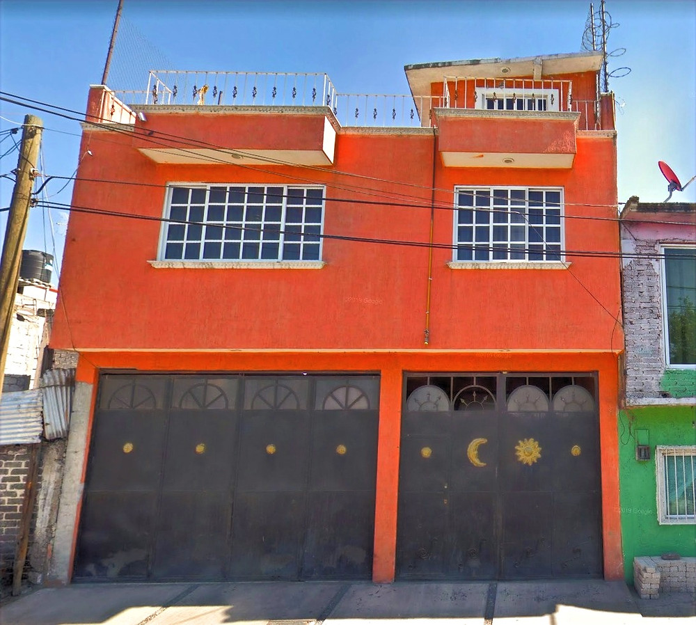 Orange building with black doors