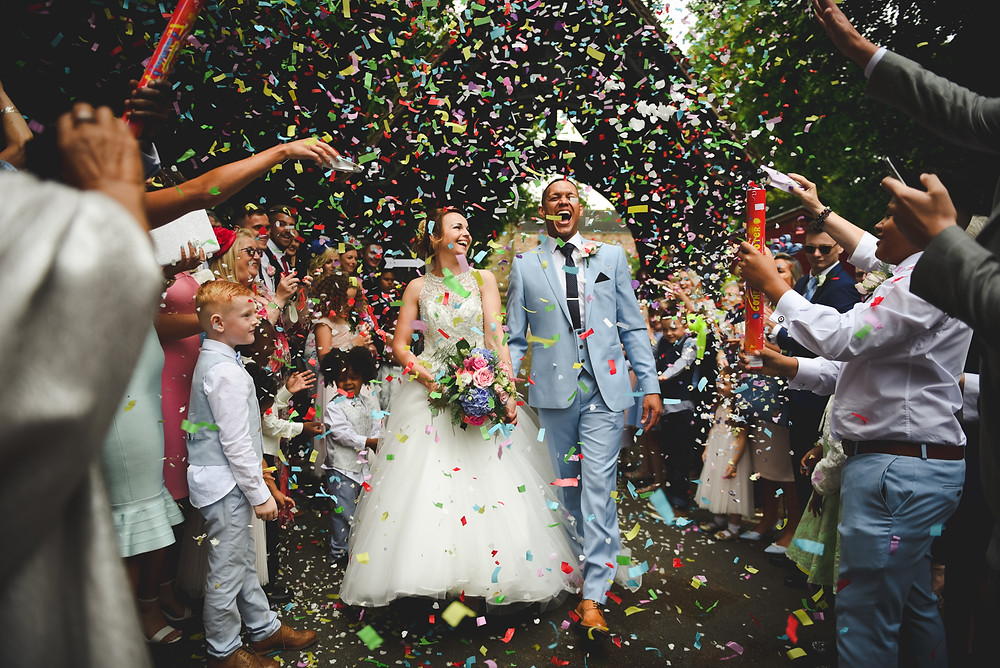 Bride & Groom being covered in confetti at Wolverhampton Wedding