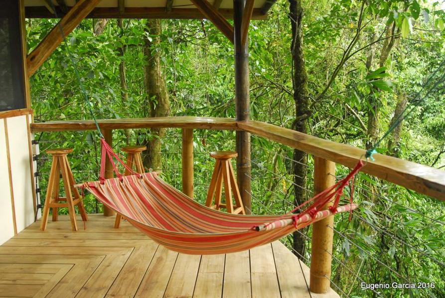 Upper balcony with hammock and bar stools