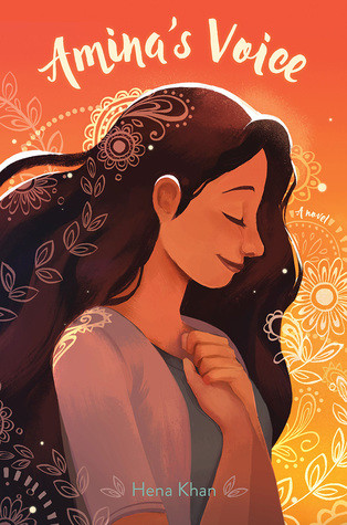A young girl with long dark hair listens to music