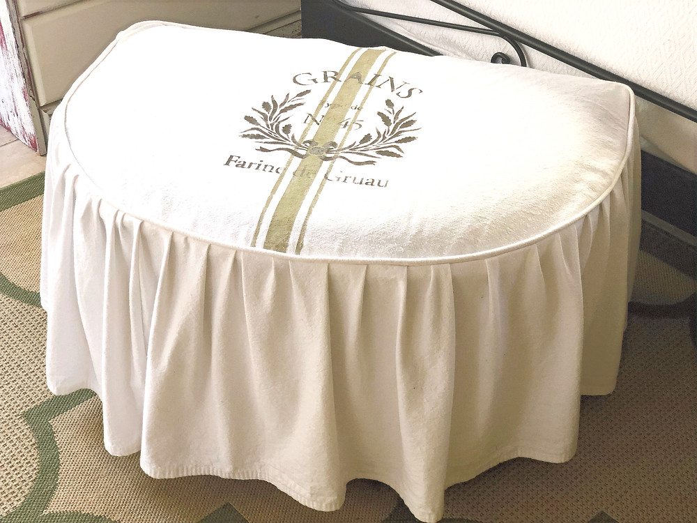 slipcovered ottoman with farmsack look and French stencil