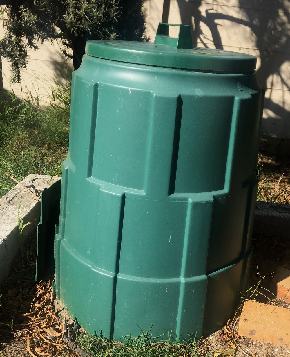 Composter bins in south Africa. Has locking top and slide at bottom to remove compost.