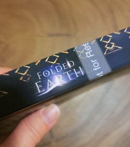 Spine of Tracy Eire's novel 'Folded Earth'.