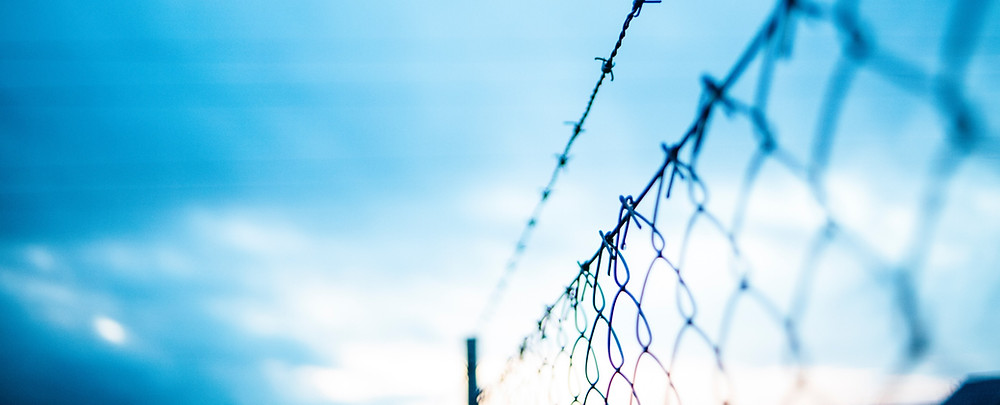 A chain link fence symbolizing the greatest barrier to our salvation.