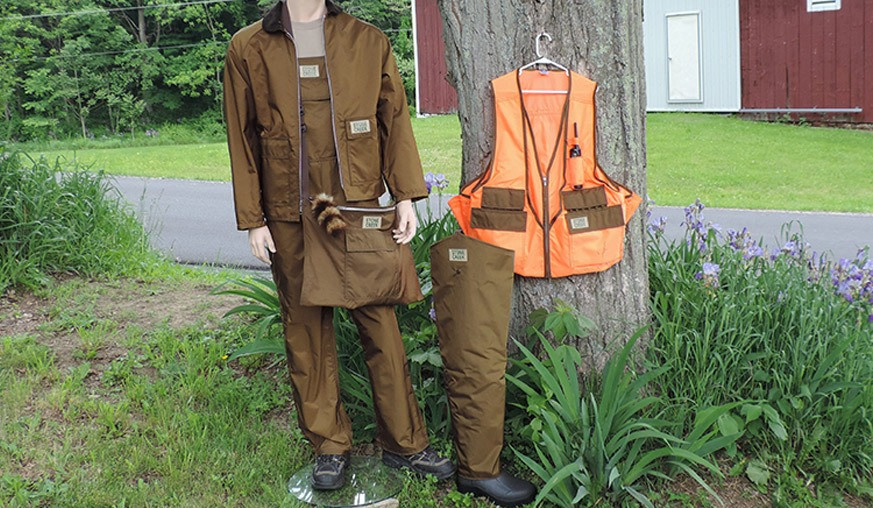 picture with Stone Creek briar proof jacket, bibs, waders, vest and game bag.