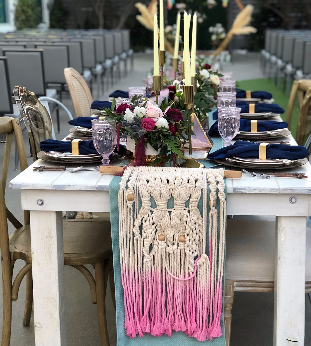A boho table setting with macrame runner