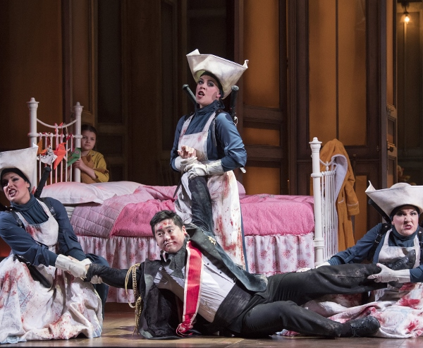 Opera North's production of Mozart's The Magic Flute Kang Wang as Tamino with Helen Évora as Second Lady, Lorna James as First Lady and Amy J Payne as Third Lady