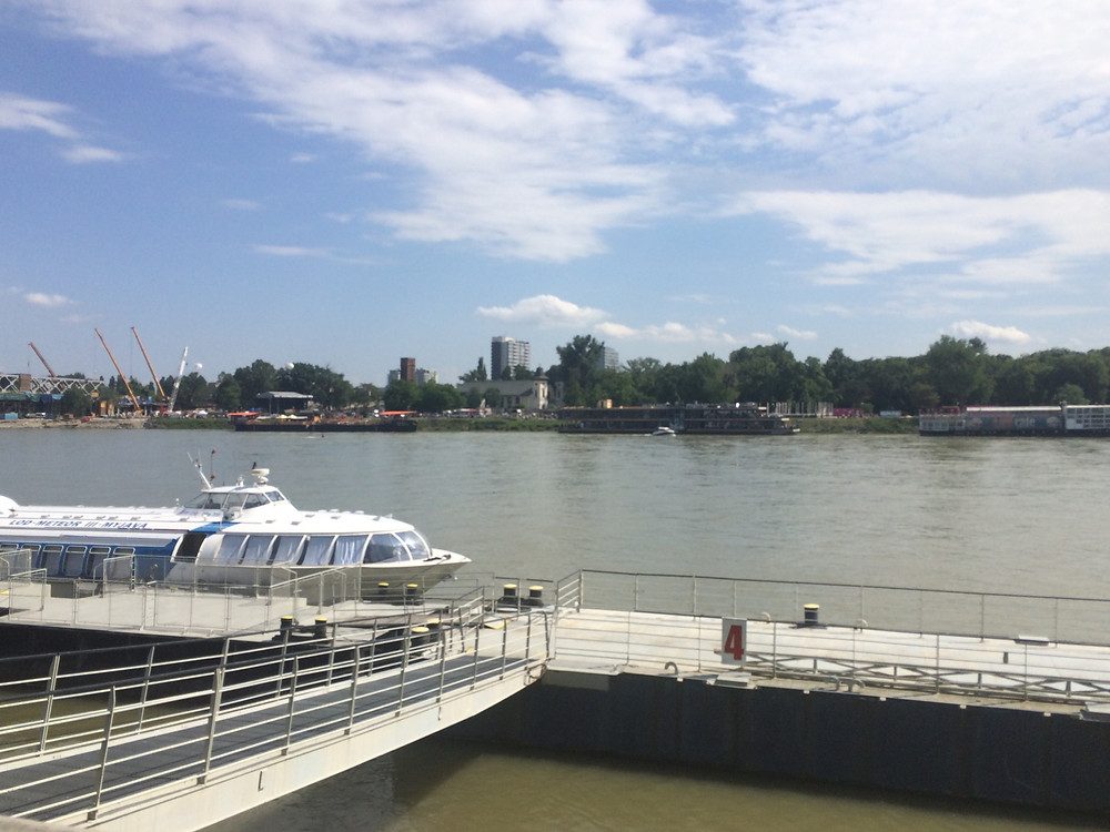 View of the Danube River with a cruise boat on it in Bratislava Slovakia
