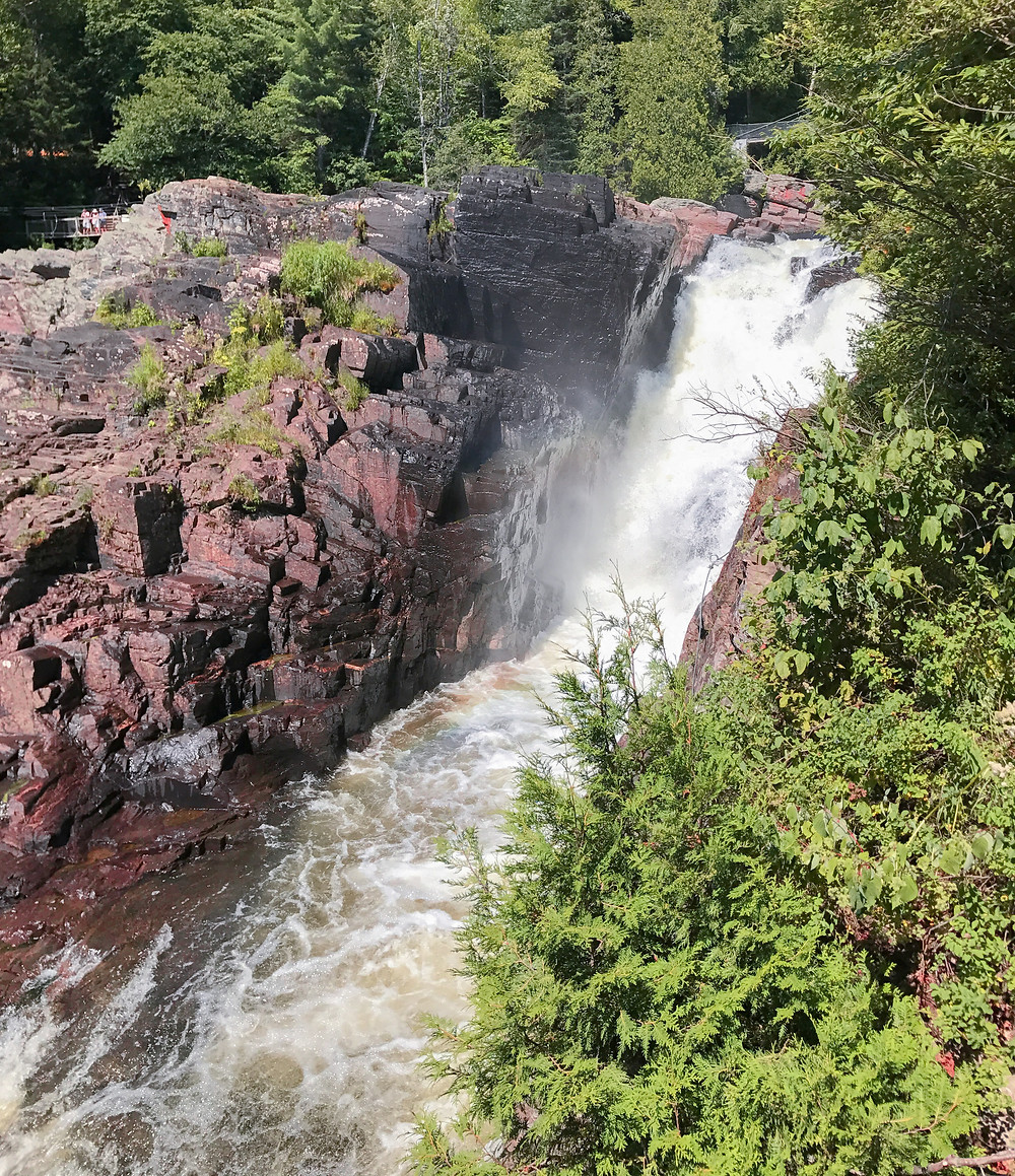 The top of the massive waterfall in quebec canada worth a road trip tour stop