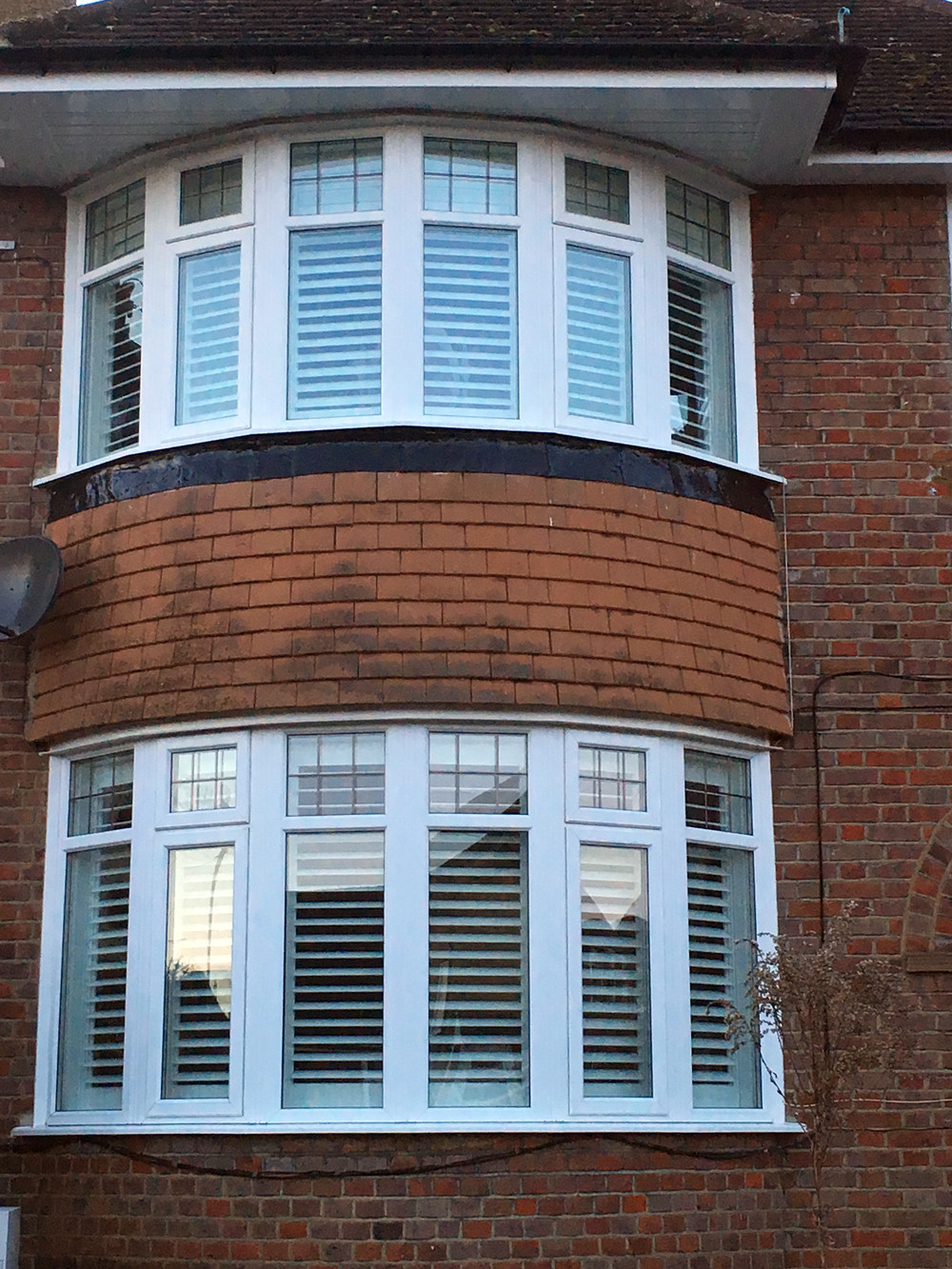 plantation shutters in a 6 panel bay