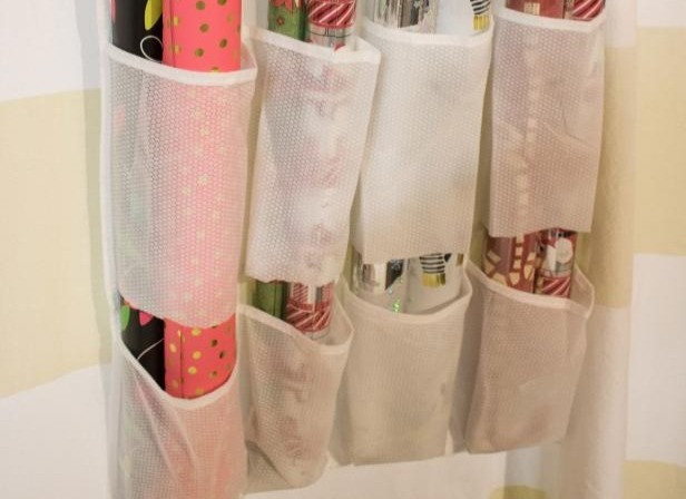 Wrapping papper rolls sitting in a shoe organizer