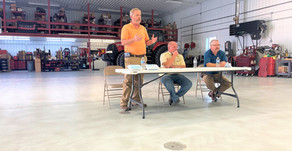 Government leaders and area farmers discuss the future of a granary