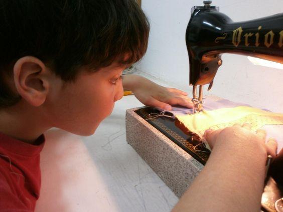 Children sewing on a machine