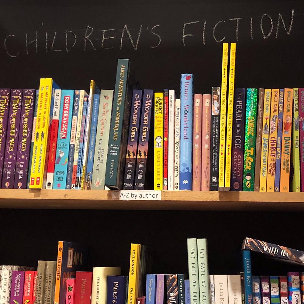 Children's books on the shelf in The Brick Lane Bookshop