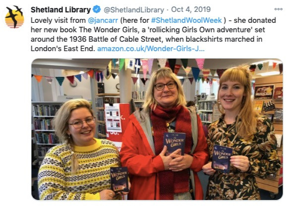 picture of the author with two librarians at The Shetland library