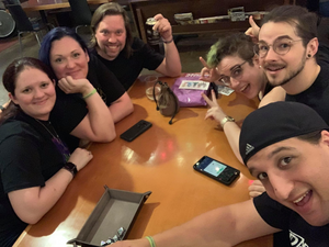 Jess & Joey of DOTS at a table with Todd & Jessie of Die Hard Dice and other friends