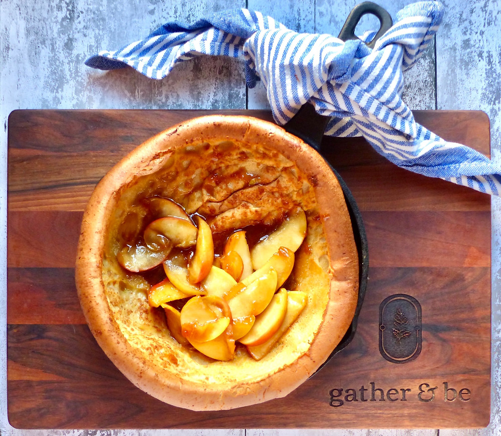 Dutch baby pancake with apples cooked in caramel sauce