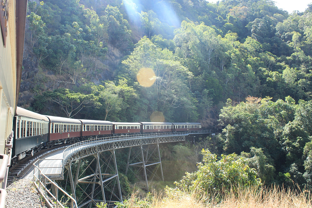 Photo of Kuranda Scenic Train turning corner around mountain.