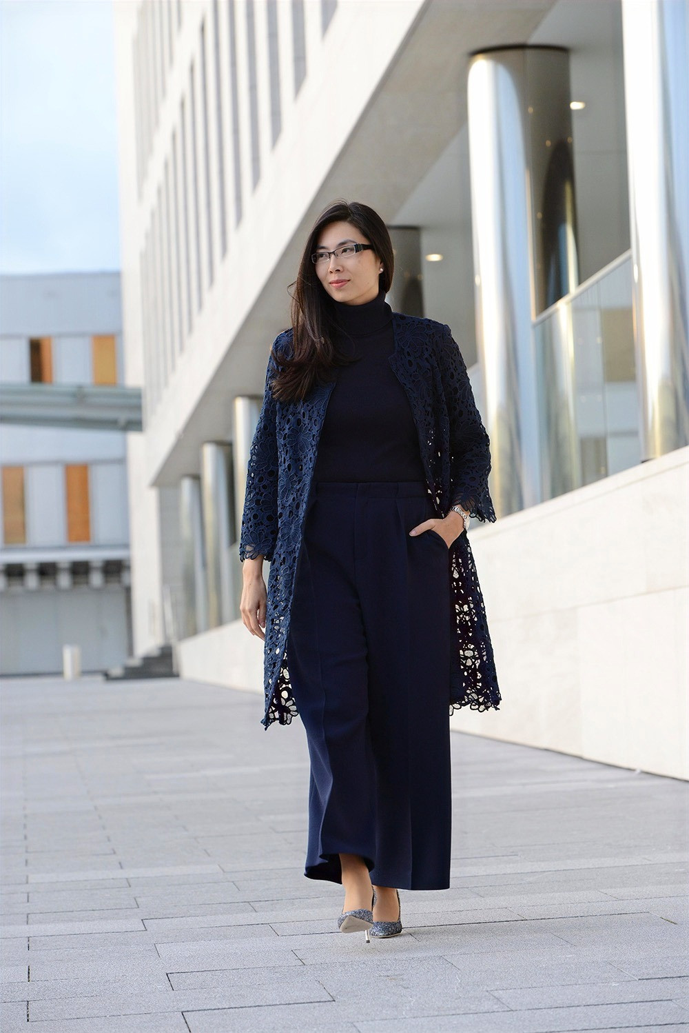 Business woman wearing a Gerard Darel navy lace coat styled with Roland Mouret navy pants.