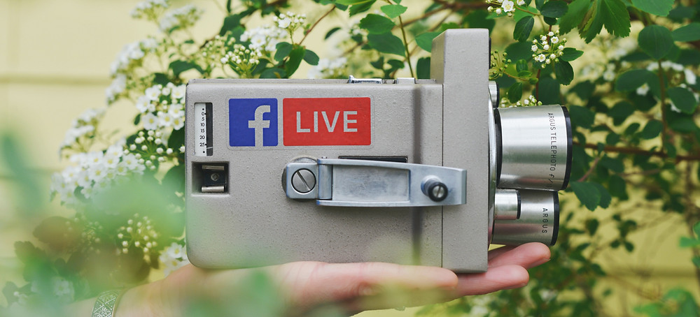 An antique camera showing Facebook Live logos. Facebook Live should be an important part of your social media strategy.