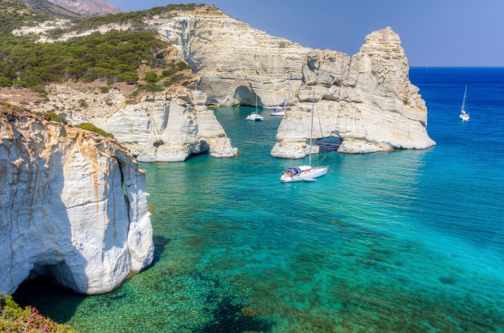 Sailing yachts in crystal blue green waters in Greece