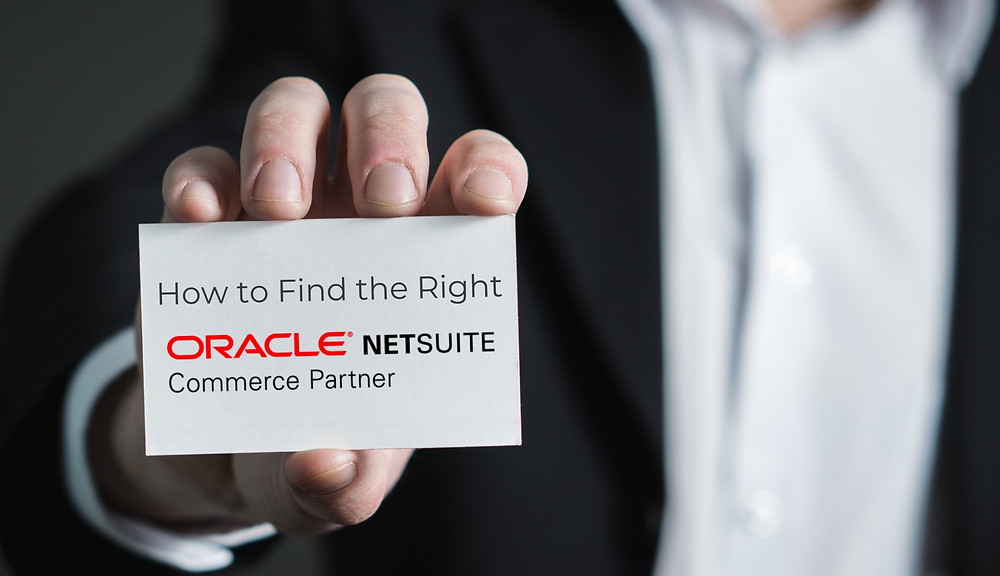"Man holding business card that reads ""How to Find the Right Oracle NetSuite Commerce Partner"""
