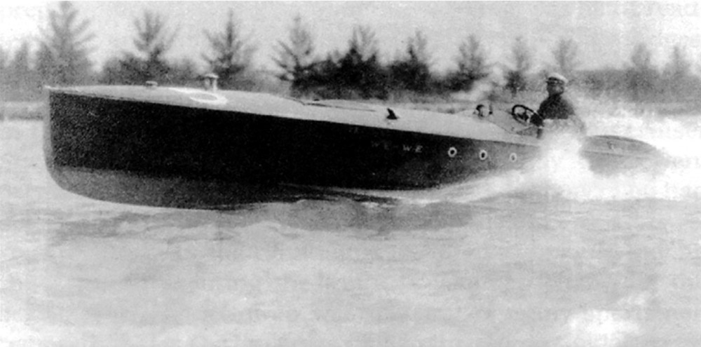 Black and white photograph of Carl Fisher driving his speedboat on Miami's Biscayne Bay