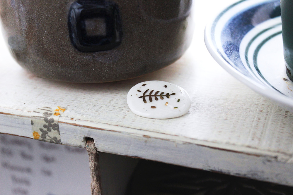 Kimberly's shelf with a ceramic bowl, dish, and tiny pin by Lithops Studio
