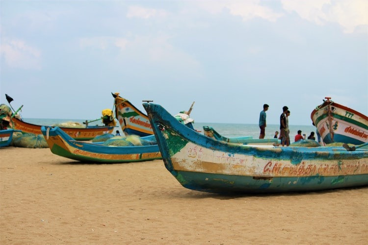 Boats on the shore of a beach