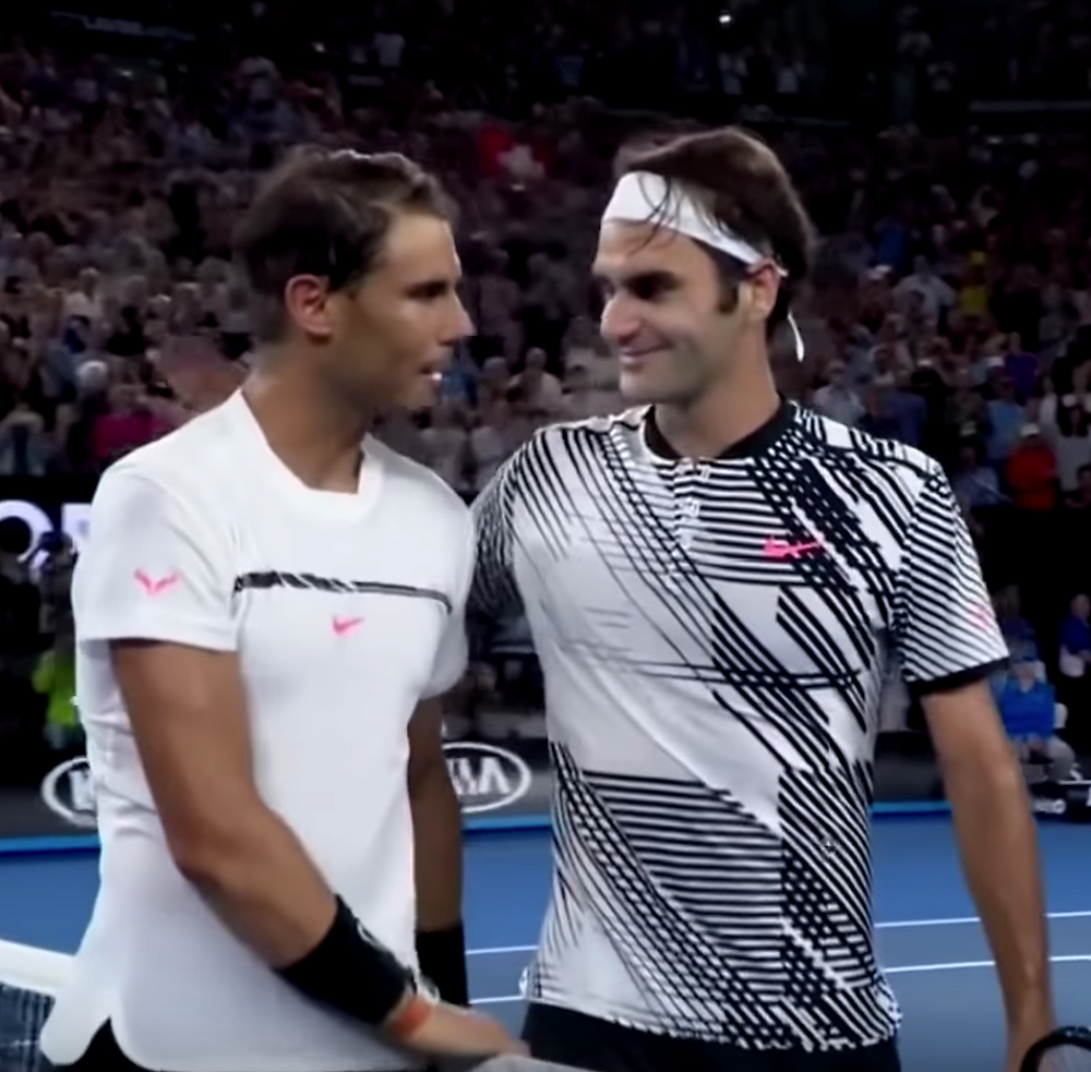 At the net post-game handshake and hug between two of the greatest players of all time.