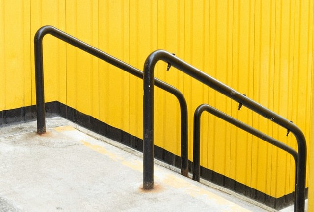 black handrail tubes with yellow vibrant background