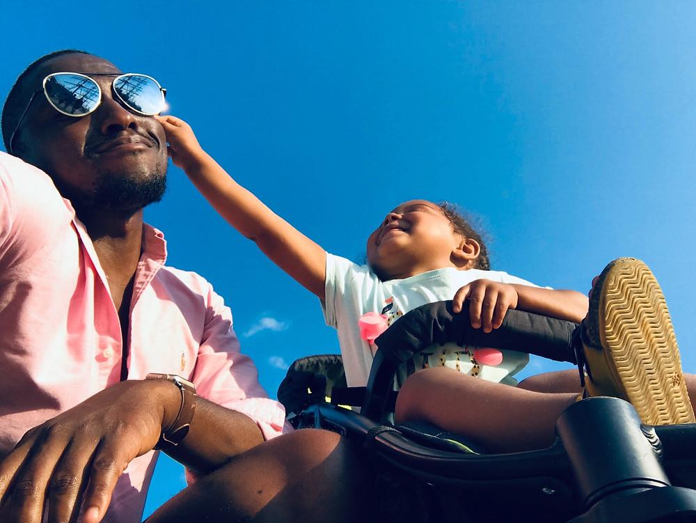 baby touching man black sunglasses