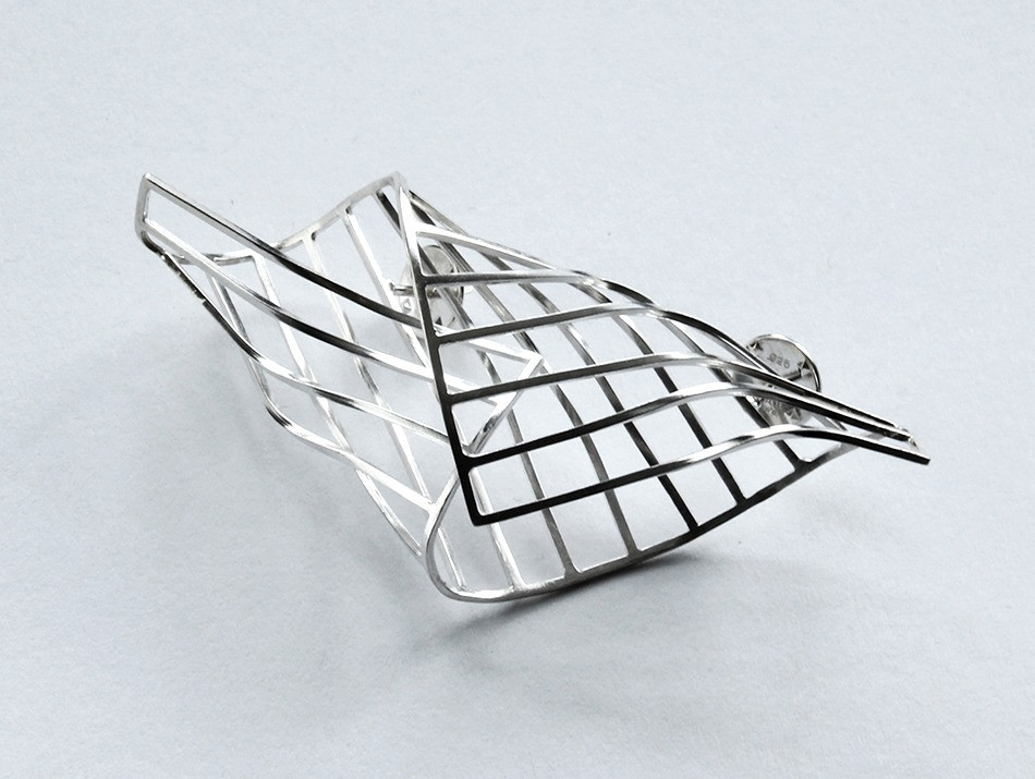 A sculptural folded polished silver cocoon brooch.