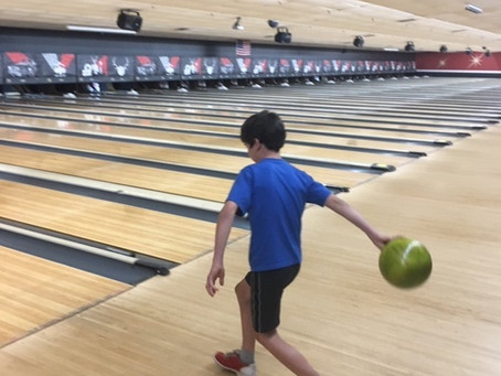A boy's bowling ball and no bologna