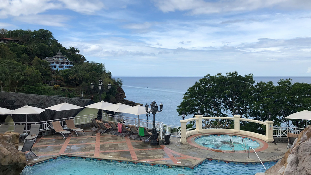 Blue skies clearing over the sea. View from Sandals Regency La Toc in Saint Lucia