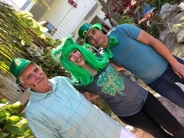 Photo of owners dressed in festive St. Paddy's day wear