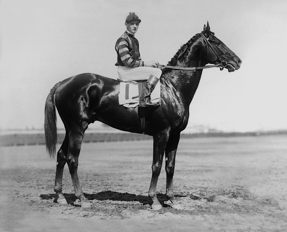 Thoroughbred racehorse Man o' War and jockey Clarance Kummer, undated.